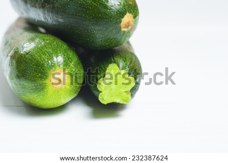 zucchini on white wood background