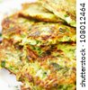 Zucchini pancakes with herbs - stock photo