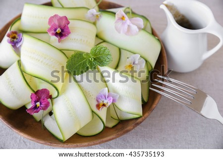 Zucchini salad with edible flowers, summer vegan salad