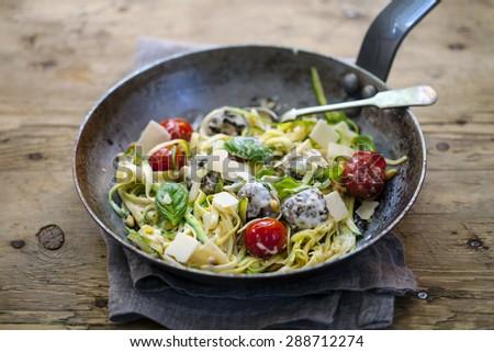 Zucchini spaghetti with meatballs - stock photo