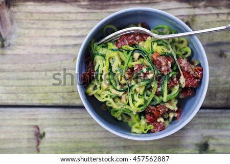 Zucchini spaghetti with sun dried tomatoes and hazelnuts