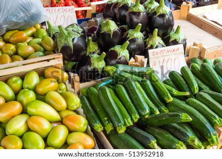 Zucchinis and aubergines for sale at a market