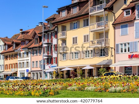 Zug, Switzerland - 6 May, 2016: buildings on Chamerstrasse street. The city of Zug is the capital of the Swiss canton of Zug.