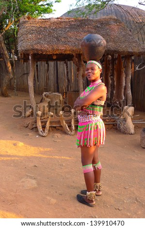 ZULULAND, SOUTH AFRICA - SEPTEMBER 14: Zulu women in traditional closes in Shakaland Zulu Village on September 14, 2009. A unique cultural center built on the set of movies Shaka Zulu and John Ross - stock photo