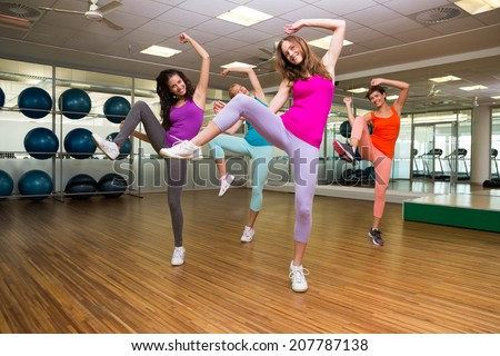 Zumba class dancing in studio at the gym - stock photo