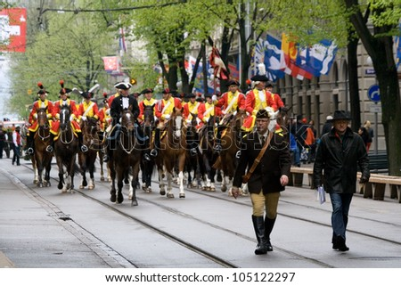 ZURICH - APRIL 16: Members of traditional annual spring parade of Guilds, ride along Bahnhofstrasse, on April 16, 2012 in Zurich.