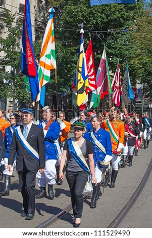 ZURICH - AUGUST 1: Representatives of professional guilds in traditional costumes marching on the Swiss National Day parade on August 1, 2009 in Zurich, Switzerland. - stock photo