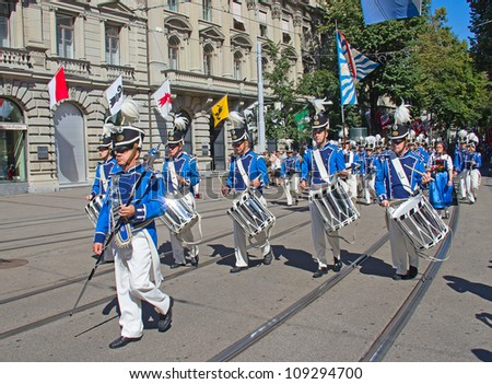 ZURICH - AUGUST 1: Zurich city orchestra in national costumes opening the Swiss National Day parade on August 1, 2009 in Zurich, Switzerland. - stock photo