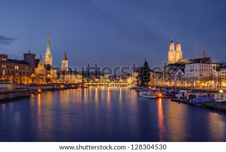 Zurich city center viewed from the river by night. Switzerland. - stock photo