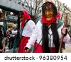 ZURICH - FEBRUARY 26: Participants in costumes perform a street procession of ZueriCarneval Fasnacht February 26, 2012 in Zurich, Switzerland. They perform Gugge Music and dress up as witches. - stock photo