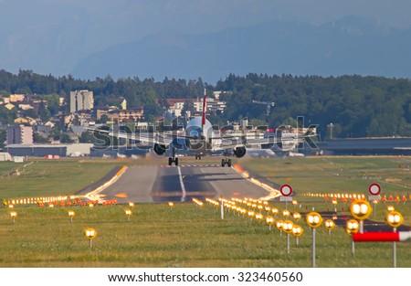 ZURICH - JULY 18: Airbus A-319 Swiss Air landing in Zurich after short haul flight on July 18, 2015 in Zurich, Switzerland. Zurich airport is home for Swiss Air and one of biggest european hubs. - stock photo