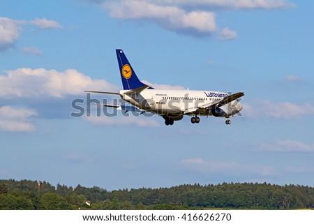 ZURICH - JULY 18: Boeing-737 Lufthansa landing in Zurich after short haul flight on July 18, 2015 in Zurich, Switzerland. Zurich airport is home for Swiss Air and one of biggest european hubs. - stock photo