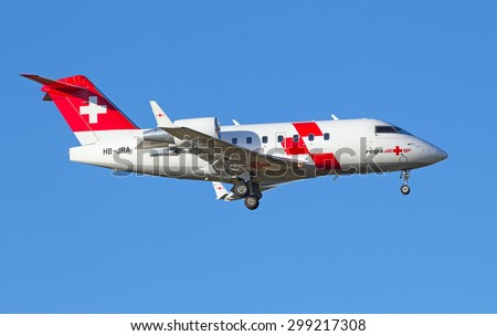 ZURICH - JULY 18: REGA Air Ambulance landing in Zurich after short haul flight on July 18, 2015 in Zurich, Switzerland. Main task of Rega Air is to carry out air-rescue and repatriation operations. - stock photo