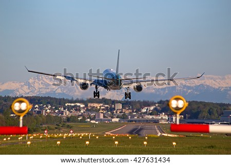 ZURICH - MAY 5: Oman Air A-330 landing in Zurich airport after short haul flight on May 5, 2016 in Zurich, Switzerland. Zurich airport is home port for Swiss Air and one of the biggest european hubs. - stock photo