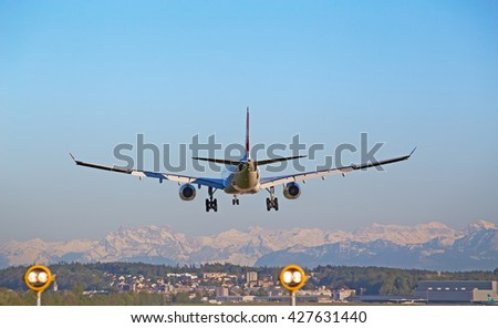 ZURICH - MAY 5: Swiss A-320 landing in Zurich airport after short haul flight on May 5, 2016 in Zurich, Switzerland. Zurich airport is home port for Swiss Air and one of the biggest european hubs. - stock photo