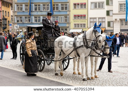Zurich, Switzerland - 17 April, 2016: participants of children's parade (German: Kinderumzug) devoted to the upcoming Sechselauten festivity on Munsterhof square in the old town of the city.