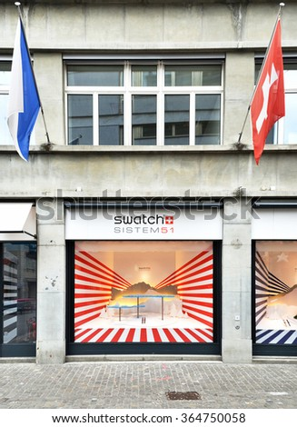 ZURICH, SWITZERLAND - DECEMBER 29, 2013 - Swatch shop, well known for its high-quality watches - stock photo