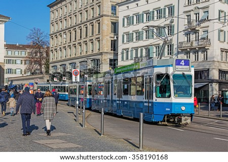 Zurich, Switzerland - 6 December, 2015: tram on the Limmatquai quay. Trams have been a consistent part of Zurich's cityscape since the 1880s, when the first horse tram ran, electrified from the 1890s.