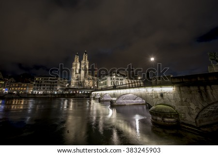 ZURICH, SWITZERLAND - FEBRUARY 23, 2016: Muster Bridge and Old Town at night