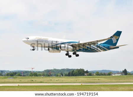 ZURICH, SWITZERLAND - MAY 25, 2014: Oman Air landing at Zurich international airport on May 25, 2014. Zurich International Airport is one of the major Europian Hubs.  - stock photo
