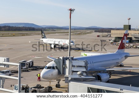 ZURICH, SWITZERLAND, on MARCH 26, 2016. Service of planes at the airport of Zurich. View from a survey terrace of the airport.