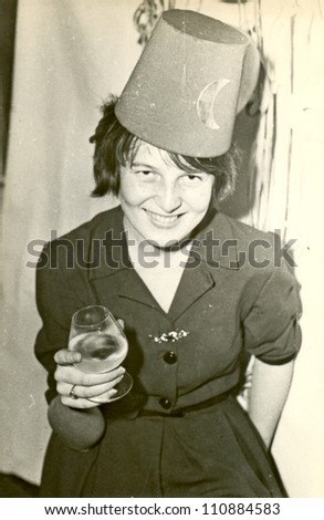 ZVOLEN, CZECHOSLOVAK REPUBLIC, CIRCA 1969 - young woman in fancy dress, a Turkish cap, probably New Year's toast - circa 1969