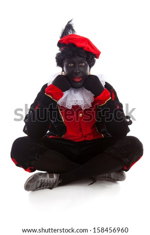 Zwarte piet ( black pete) typical Dutch character part of a traditional event celebrating the birthday of Sinterklaas in december over white background