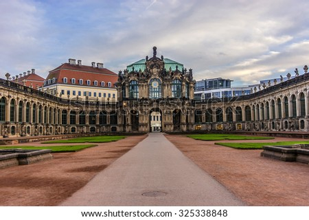 Zwinger Palace (architect Matthaus Poppelmann) - royal palace 17 century in Dresden, Germany. Today, Zwinger is museum complex and most visited monument. Evening, lanterns, lighting.
