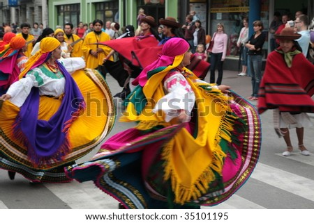 ZYWIEC, POLAND - AUGUST 6: Participants of the 46th Beskidy Highlanders Week of Culture (TKB), the biggest folk culture event in Eastern Europe, parade through the city, folk group from Ecuador