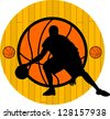 A silhouette of a basketball - stock photo