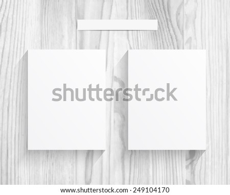 2 Blanks sheet of paper on white wood texture background - stock vector