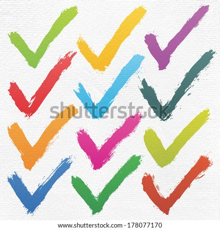 12 color ink sketch check mark on watercolor paper. Isolated shape on white background. Aquarelle abstract textured in handmade technique. Vector illustration clip-art design element in 10 eps - stock vector