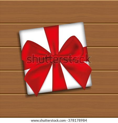 Gift Box with Bow on Wooden Background - stock vector