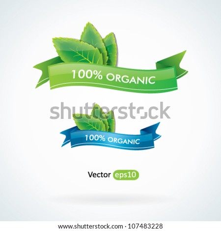 100% organic label with green leaves - stock vector