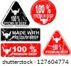 100 percent and made with premium beef rubber stamp - stock vector