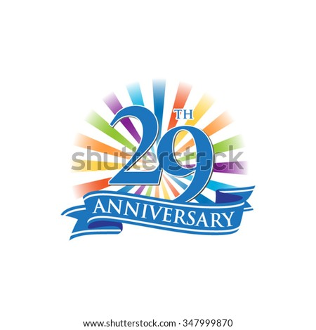 29th anniversary ribbon logo with colorful rays of light