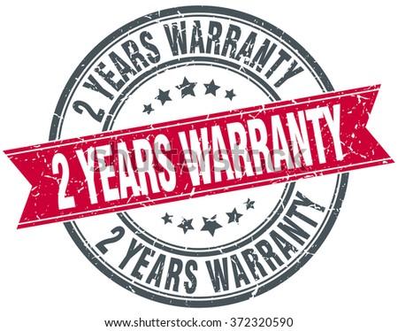2 years warranty red round grunge vintage ribbon stamp - stock vector