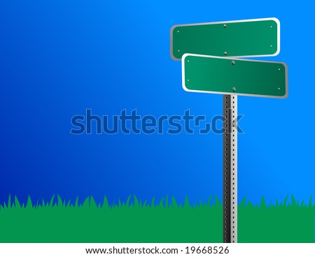 A blank green road/street sign is against a bright blue sky and grass is behind it.