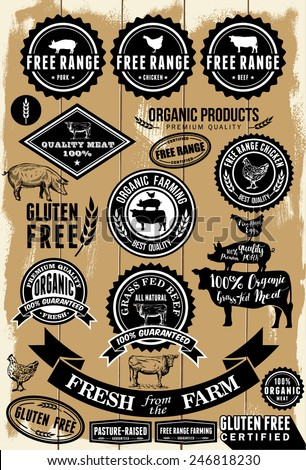 A collection of free range and organic labels on wooden background . All labels are grouped. EPS 8 - stock vector