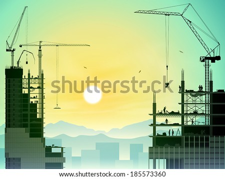 A Construction Site with Tower Cranes and Sunset, Sunrise