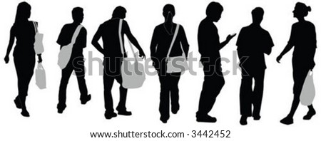 A group of people silhouettes walking on street