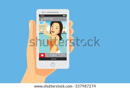 A Hand holding smart phone as screen showing woman picture in social media which he follow and like