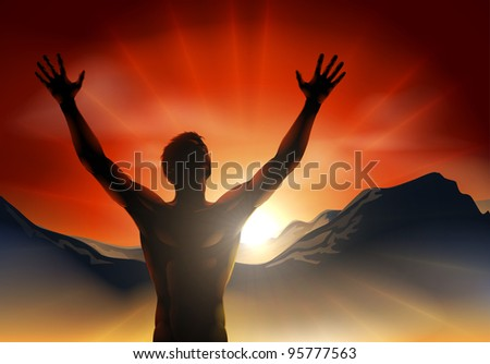 A man at sunrise or sunset with hands raised and sun rising over mountains.
