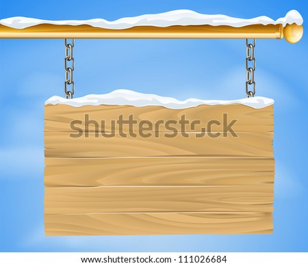 A rustic wooden snow covered winter Christmas sign hanging suspended from a brass metal pole with the blue sky in the background