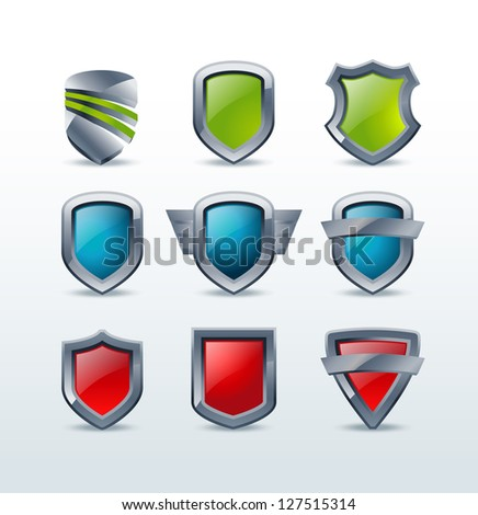 A set of colorful shiny metallic shield icons vector illustration - stock vector