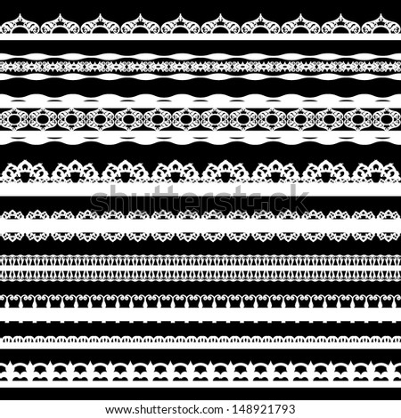 A set of cute white lace ribbons on a black background. Vector illustration