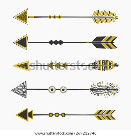 A set of five arrows, tribal decoration in black and golden, isolated on white. - stock vector