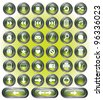 A set of 38 shiny green buttons with metallic borders. - stock photo