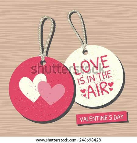A set of two vintage Valentine's Day gift and sale tags on wooden background. - stock vector