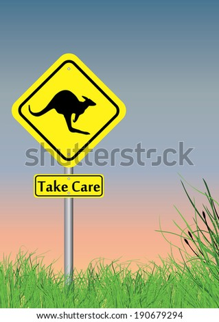 a take care of kangaroo sign with grass on lower section